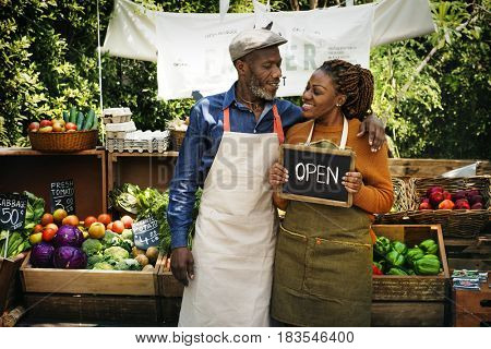 African couple owner fresh grocery organic shop