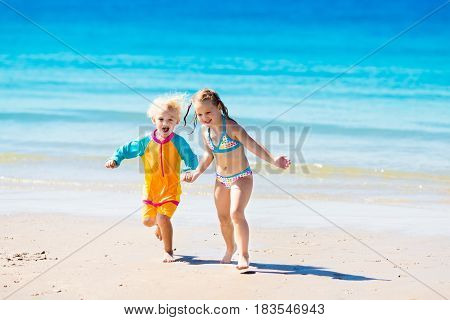 Kids Run And Play On Tropical Beach