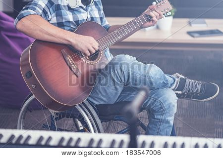Enjoying my inspirational weekend. Involved talented young invalid sitting on the wheelchair indoors and enjoying musical therapy while playing guitar