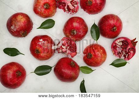 Pomegranates on snow background
