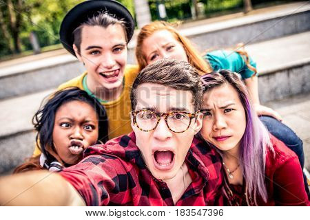 Multi-ethnic group of teenagers taking a selfie
