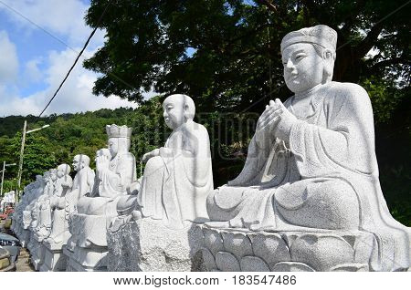 Carving Chinese buddha image from granite stone