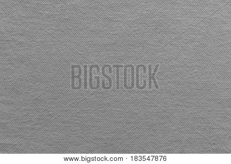 the textured background of cotton fabric or textile material of gray color