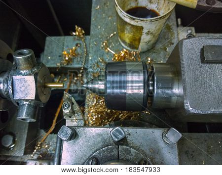 old manual lathe closeup with selective focus, custom collet chuck and center