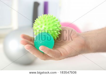 Male hand with stress balls in clinic