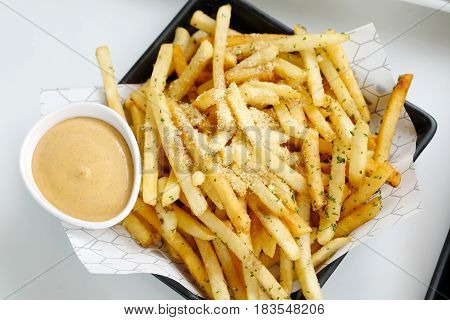 French fries topping with cheese served with mayo sauce korean style