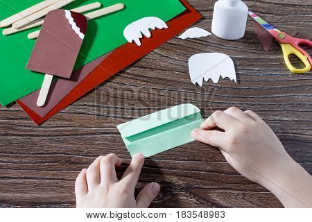 The Child Folds The Paper Details Of The Craft. Creates A Child The Gift Of Paper Popsicle. Made By