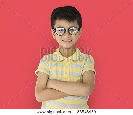 Boy with eyeglasses smiling in shoot