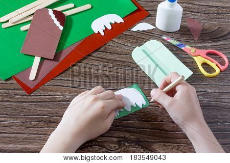 The Child Draws Paper Details Of The Craft. Creates A Child The Gift Of Paper Popsicle. Made By Hand