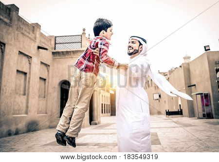 Arabic family playing with child in the old Dubai