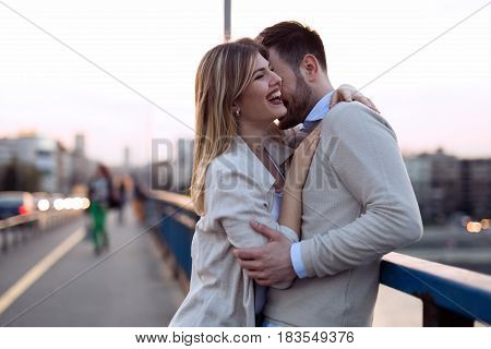 Happy romantic couple in love hugging and smiling