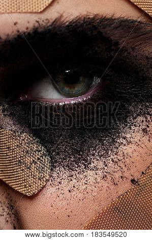 Closeup photo of beauty Woman with Parches on her Face and black Powder Make-up