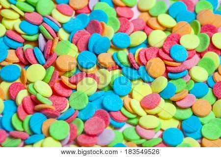 MacroPhoto of colorful neon confectionery sprinkles candies for background use, top view, closeup