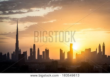 Dubai skyline silhouette at sunset, United Arab Emirates