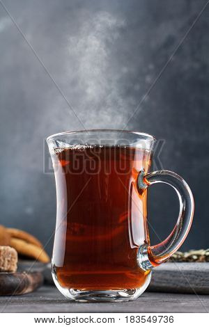 Steaming Cup Of Tea, Still Life On A Dark Background