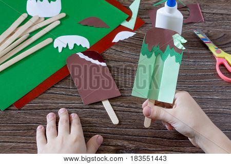 The Child Creates A Gift Of Paper Chocolate Popsicle And Mint Popsicle. Made By Hand. The Project Of