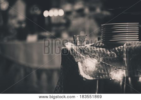 A batch of white dishes on the table with star lighting and blurred background