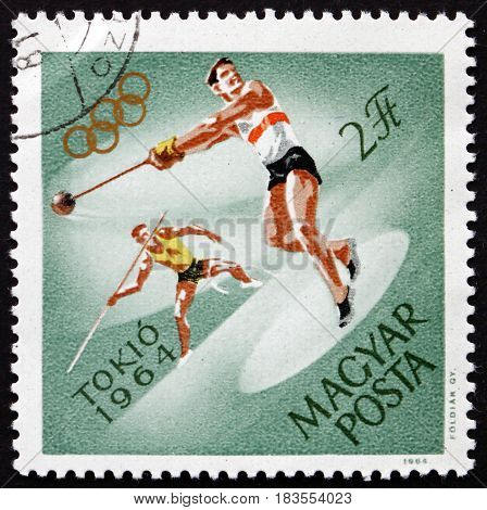 HUNGARY - CIRCA 1964: a stamp printed in Hungary shows Hammer throw and Javelin 18th Olympic Games Tokyo circa 1964