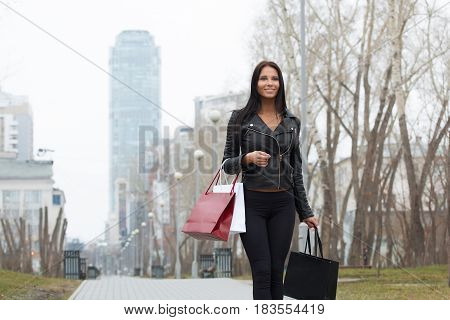Portrait of happy woman after shopping in the city.