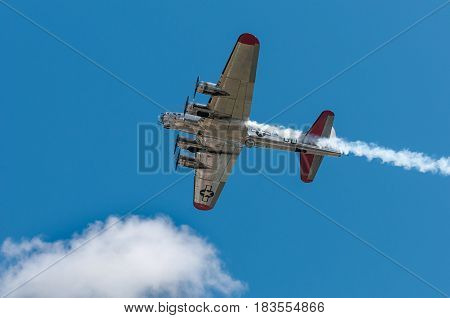 EDEN PRAIRIE MN - JULY 16 2016: B-17G bomber Yankee Lady flies directly overhead at air show. This B-17 was a Flying Fortress built for use during World War II but never flew in any combat missions.