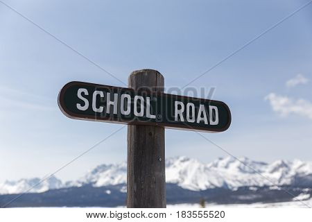 Wooden road sign with
