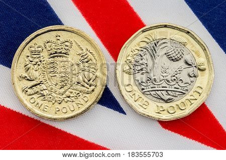 Comparison Of Old And New British Pound Coins. Tails.
