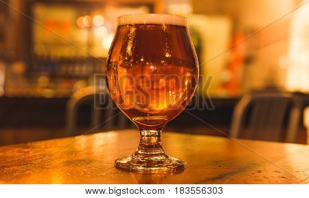 Strong Beer In Curved Glass