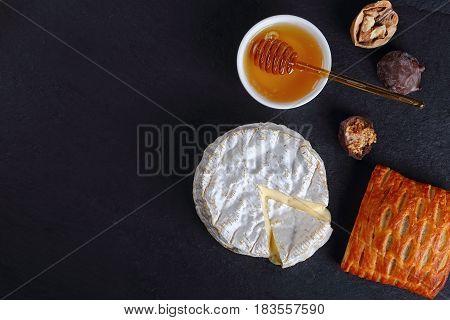 Cheese Camembert Cut In Slice On Slate