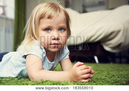 closeup portrait of a funny little girl. child playing at home