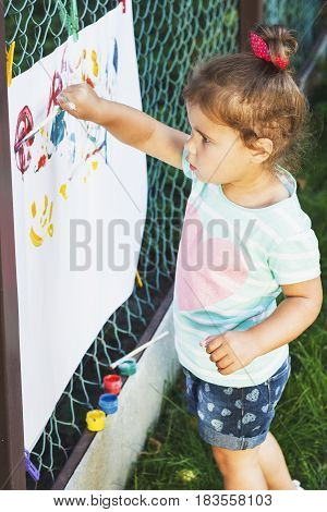Small Girl Draws By The Brush Colorful Paintings