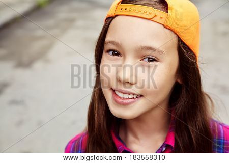 Beautiful teenage girl outdoors. youth lifestyle. portrait of adolescent in the city