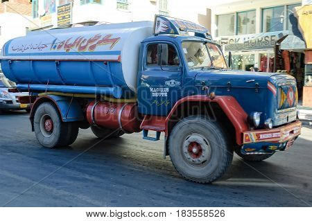 Hurghada, Egypt - November 7, 2006: Old tank truck driven by arabian driver moves on city street