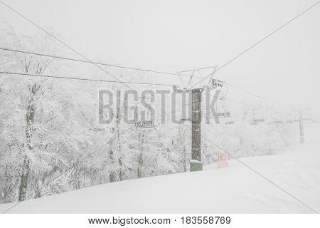 Ski lift over snow mountain in ski resort