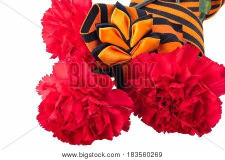 Three red carnations wrapped in a georia ribbon isolated on a white background