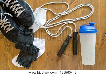 Men's set of things for playing sports on a wooden background