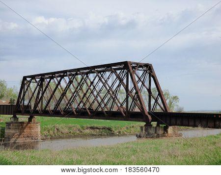 A old railroad bridge across a river.