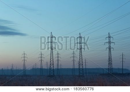 High-voltage line in the fog, Leningrad Region, Russia