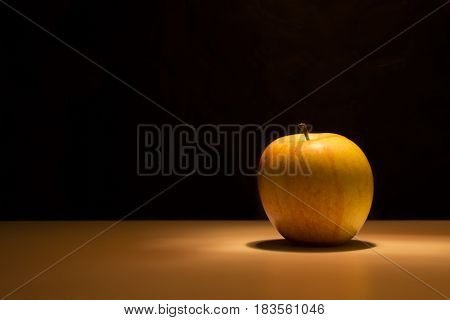 Delicious apple on a black background natural source of vitamin
