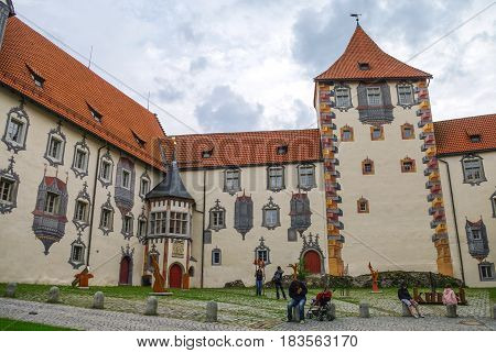 Fussen, Germany - August 17, 2010: Hohes schloss medieval castle in the middle of Fussen old town Bavarian Alps Germany