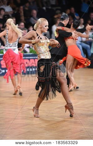 Stuttgart Germany - August 14 2015: An unidentified latin female dancer in a dance pose during Grand Slam Latin at German Open Championship on August 14 in Stuttgart Germany