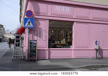 GRAZ, AUSTRIA - MARCH 20, 2017: Pink cake shop on corner of street in Graz the capital of federal state of Styria Austria.