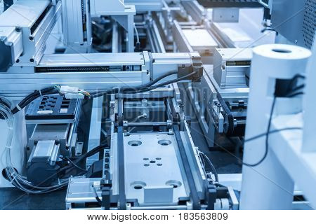industrial machine robot in assembly line working in factory. Smart factory industry 4.0 concept.