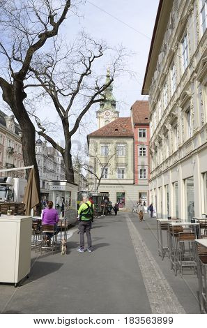 GRAZ, AUSTRIA - MARCH 20, 2017: People at the plaza of Iron Gate next to the main street of of Graz the capital of Styria Austria