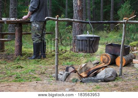 Cooking food at stake in the forest