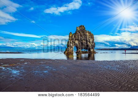 Soft northern sun. Concept of northern extreme tourism. Magic Rock Hvitsercur at sunset. Northern coast of Iceland