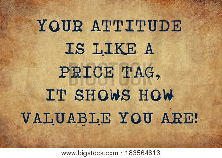 Inspiring motivation quote with typewriter text your attitude is like a price tag, it shows how valuable you are. Distressed Old Paper with Typing image.