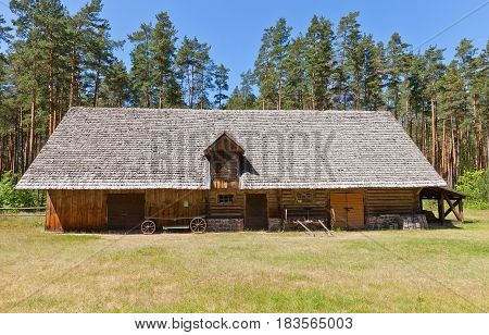 RIGA LATVIA - JUNE 13 2016: Cattle shed with cart shed (circa 1924) of Laiminas peasant farmstead in Latvia. Exhibited in Ethnographic Open-Air Museum of Latvia since 1996