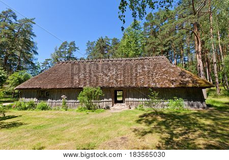 RIGA LATVIA - JUNE 13 2016: Fisherman chimneyless dwelling house (circa 1750s) of Kursi farmstead of Kurzeme ethnic group. Exhibited in Ethnographic Open-Air Museum of Latvia since 1939