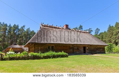 RIGA LATVIA - JUNE 13 2016: Living rural house (circa 1848) of Veskerves farmstead of Kurzeme ethnic group. Exhibited in Ethnographic Open-Air Museum of Latvia since 2001