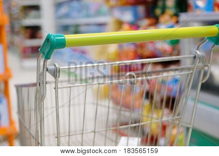 Shop trolley in a supermarket close up